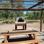 A wood fired oven built in an outdoor area