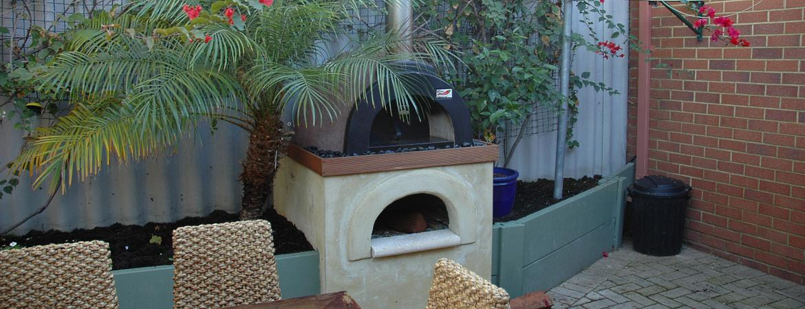A wood fired oven from DIY Wood Fired Ovens Qld that fits neatly into a small backyard